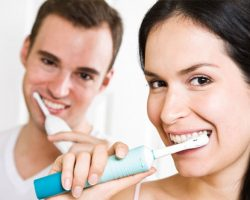 Couple Brushing their tooth together | The Foehr Group in Bloomington, IL | Dr. Wolf