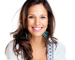 Confident woman smiling| The Foehr Group in Bloomington, IL | Dr. Wolf