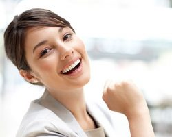 Young Professional Woman Laughing | The Foehr Group in Bloomington, IL | Dr. Wolf