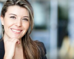 Young Professional Woman Confidently Smiling | The Foehr Group in Bloomington, IL | Dr. Wolf